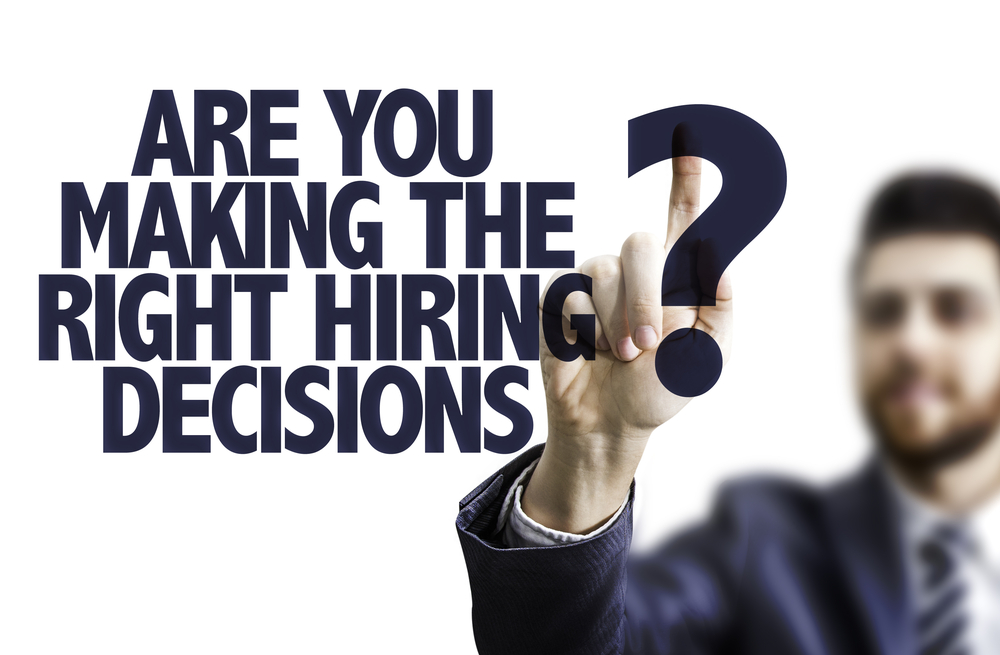 Business man pointing the text Are You Making the Right Hiring Decisions?