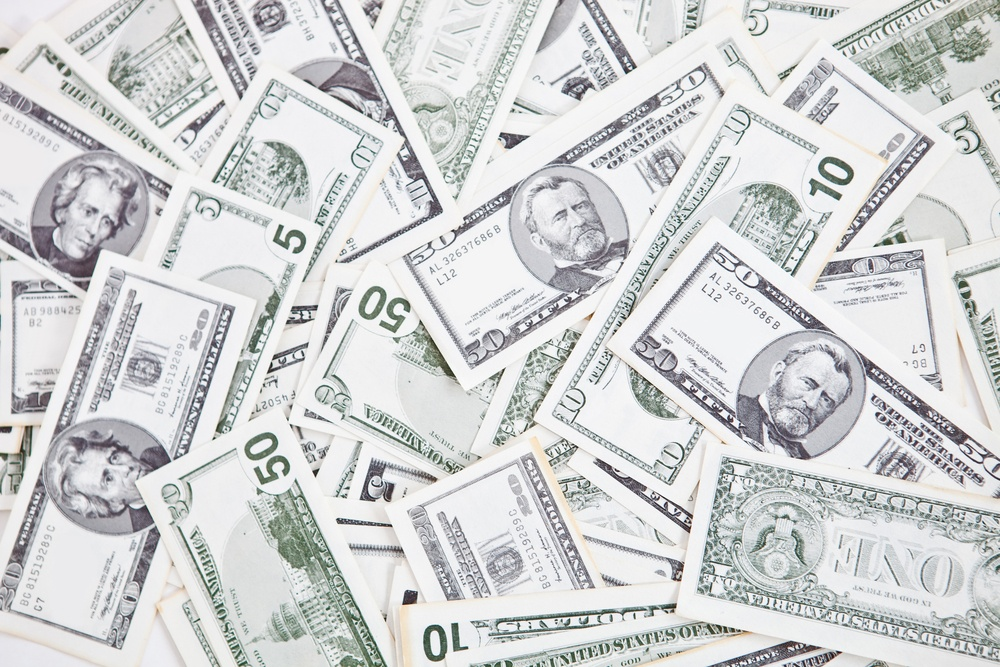 Closeup to a bunch of dollar bills - money concepts