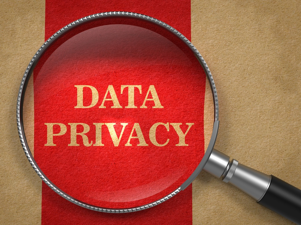 Data Privacy. Magnifying Glass on Old Paper with Red Vertical Line..jpeg