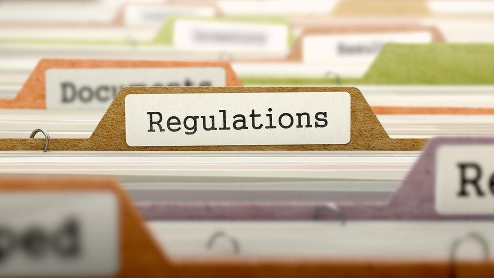 Regulations - Folder Register Name in Directory. Colored, Blurred Image. Closeup View..jpeg