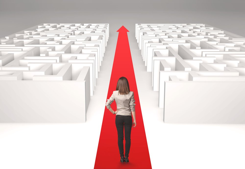 Successful businesswoman in front of a separated labyrinth, concept about simple solution-1